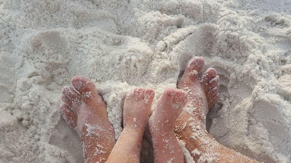 Piggies on beautiful white Pensacola Beach sand